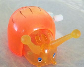 Tomy (R) Snail Wind-Up Toy