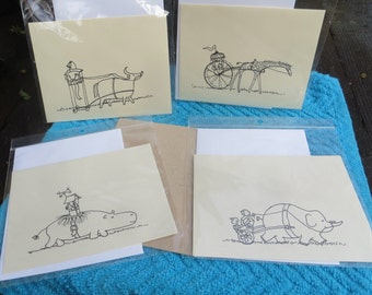 Playful and fanciful animal rides -- note cards, set of four