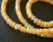 Golden Ethiopian Opal Polished Roundels - Half Strand - 3 to 4mm - 8 Inches