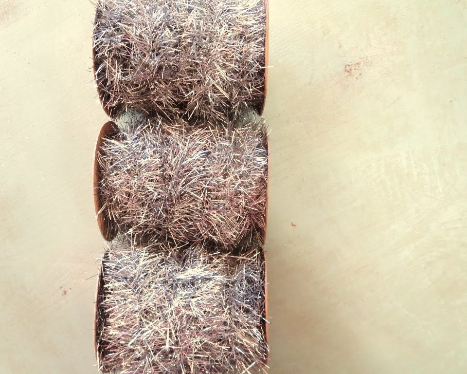 Vintage style tinsel garland ribbon in silver feet