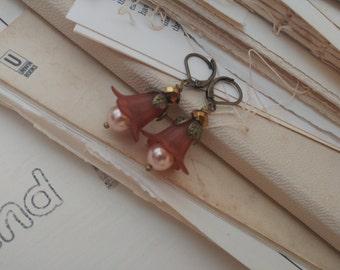 Burnt rust pearl flower earrings.