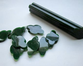 Vintage fancy bakelite tested rod green 4 petal flower design w 8 slices