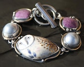 purpurite, mabe pearl, porcelain owl, gold filled wire and sterling silver metalwork link bracelet