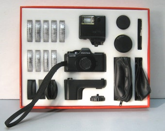 Vintage Pentax Auto 110 Camera Set with Flash, Filters, Extra Lenses, Instructions, Cases and Original Box
