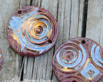 Essential oil pottery bead in a swirly pattern