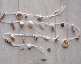 "English seaglass  garland , holed shells, beads, pebbles, driftwood ,sea foam finish 63""long"