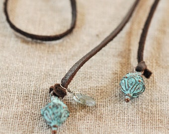 antiqued bronze dangles adorn tie-on leather strand necklace
