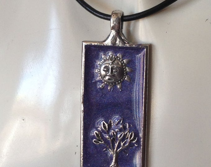 Sun and tree with purple background on leather necklace. Handmade in Australia. Pewter and Resin