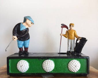 Cast Iron Golfer and Caddy Mechanical Bank