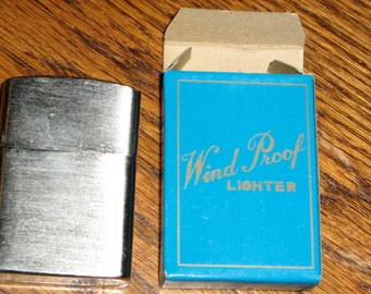 vintage golden bell Japan lighter new old stock with box