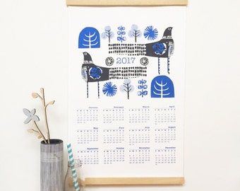 2017 screen printed calendar with wooden hangers and hanging loop