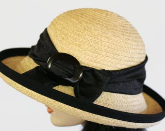 Raffia Straw wide brim straw sun hat with black trim and belt loops and black textured scarf and  coconut buckle