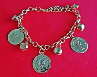 """Vintage gold tone 8 """" bracelet with 2"""" extension, coin and bell charms in great condition, appears unworn"""