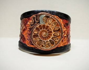 Adjustable brown leather bracelet cuff with ammonite fossil and snake skin. Handmade leather bracelet.