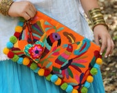 Orange and Multi colored Otomi clutch with pompoms and hand embroidered tassels
