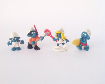 Lot of 4 vintage Smurf Smurfs figurines Gymnast snorkeler swimmer tennis player Smurfette Surfer