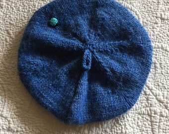 """Blue Tam.  Adorable blue tam with lucky ladybug on hat  End of year sale.  Fits head circumfetence 16-18""""  Sale is final."""
