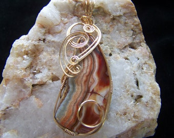 14K gold wire wrapped stone pendant