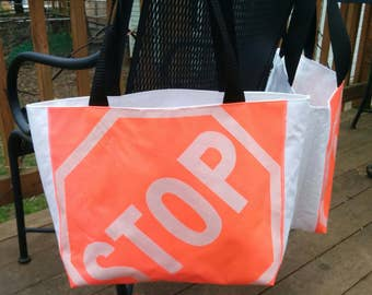 STOP tote - limited edition - made from repurposed STOP flags and waterproof tent awning