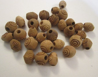31 vintage wood beads - unpainted - round and oblong with bullseye design - 1/2 inch