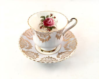 Vintage Paragon Rose Teacup / Blue white and  gold floral teacup