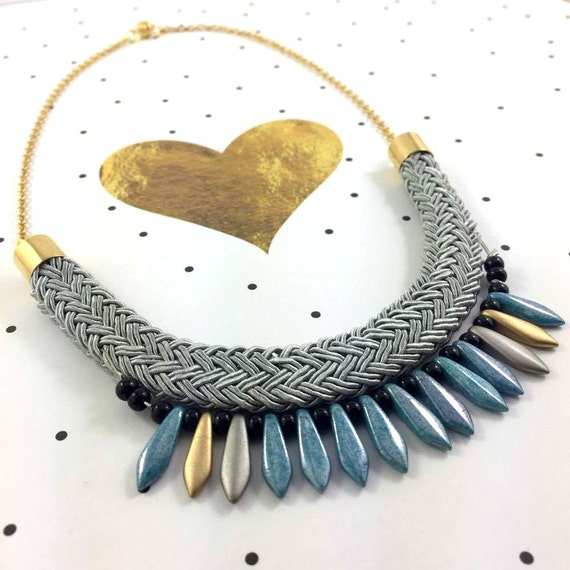 Ajustable necklace on gold color chain with blue black gold beads and  on gray braided polyester cord