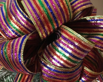 Lg Christmas Tree topper bow made of a multi colored striped ribbon 8 ft. tails