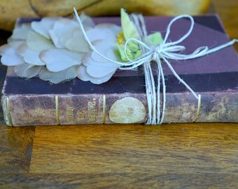 Vintage French leather bound book and vintage silk flower tied with linen string published in Paris antique book collectible French decor