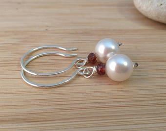 Genuine Garnet Earrings. White Swarovski Pearls. Red Gemstone Earrings. Sterling Silver Pearl Earrings. Red Garnet Gemstone. Classic Pearls.