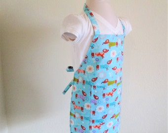 Childrens Apron - A sweet Kids Apron covered with dogs..hot dog dogs...on a vibrant sky blue, a great cooking or arts and crafts apron