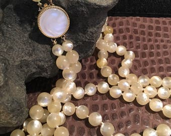 Beautiful Mother of Pearl look double stranded beaded necklace .