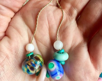 Colorful handcrafted pink and blue lampwork glass and stone necklace. One of a kind jewelry for spring and summer.