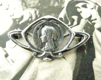 Antique French art nouveau silver brooch of the Virgin Mary, signed