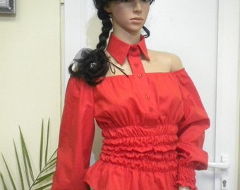 Elegant ladies red shirt with bare shoulders and elastics.