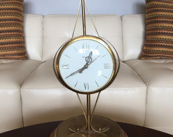Mid century United clock 1950s gold brass wooden base mantel table