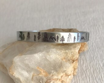 Mountain Forest Stamped Bracelet, thin adjust cuff silver aluminum mountains tree climb hike camp adventure jewelry woman gift gifts for her