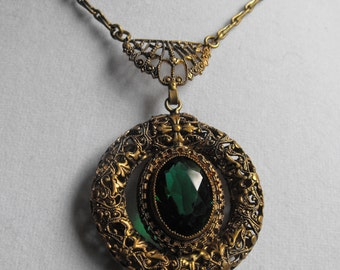 Emerald green glass in Victorian revival setting  brass filigree setting Filigree medallion