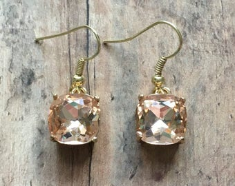 Nickel free!  Gorgeous peach crystal dangle earrings