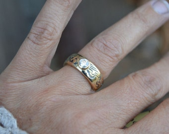 Handcrafted mokume gane engagement ring with low set full bezel stone