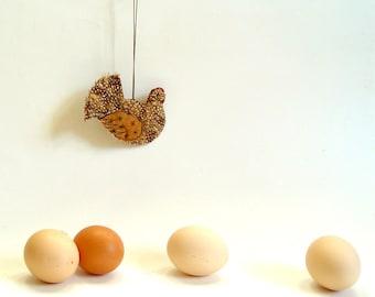 Hanging hen ornament in brown farmhouse decor