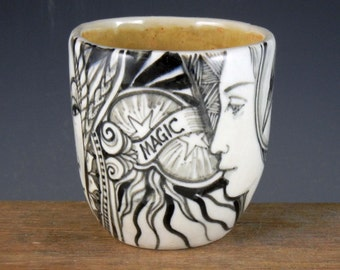 """Magic porcelain cup black and white with faces raven """"magic"""" and more"""