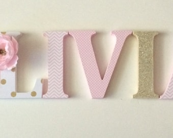 Wooden  letters for nursery in pink, white and gold