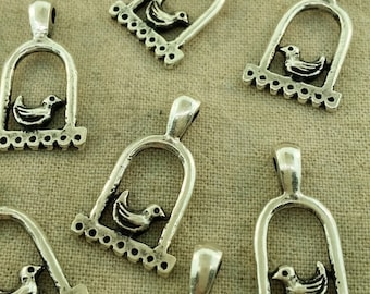 Silver bird in cage charms