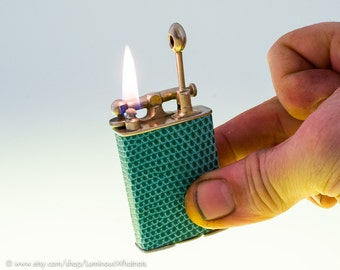 1920s Clark Gold Plate Lift Arm Pocket Lighter With Teal Lizardskin Covering