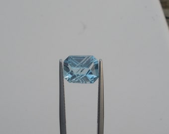 Blue topaz emerald laser cut gem 10 x 8mm