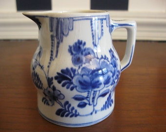 Small Delft pitcher in blue and white, holds 4 ounces