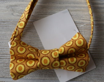 Boys  mustard  dot bow tie made for newborn to age 12.