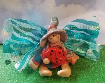 fairy troll holding a ladybug, Mini garden accessories, polymer clay miniature, colorful mini pixie