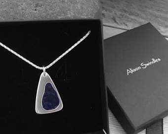 "Silver and dark blue enamel pendant on an 18"" spiga chain"