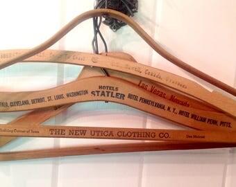 4 vintage wood hangers Advertising printed on one side Sahara Hotel New Utica Clothing Company Hotels Statler Sheraton hotel